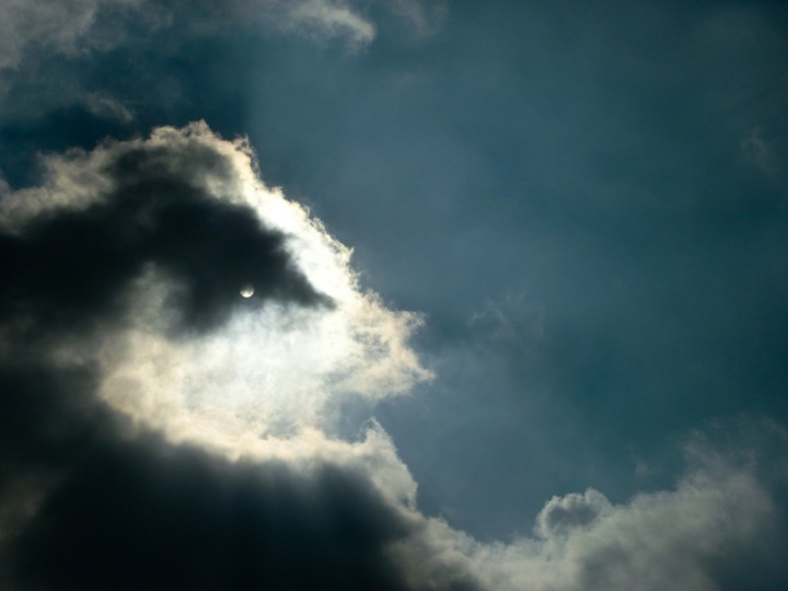 sun behind clouds 1