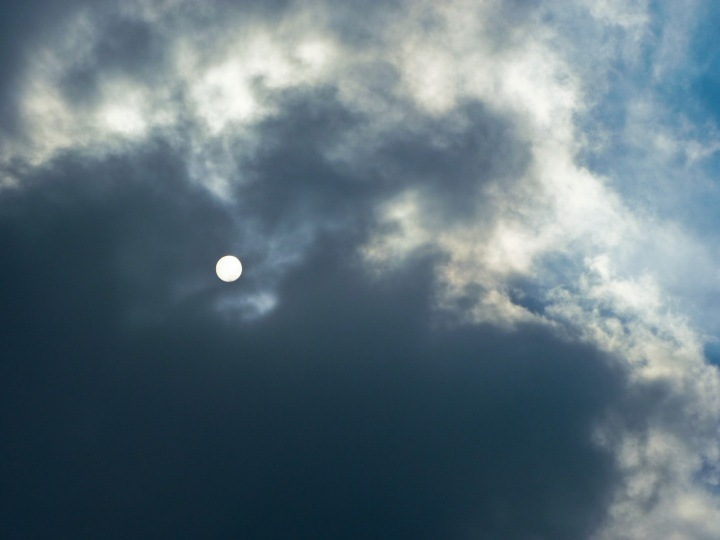 sun behind clouds 2